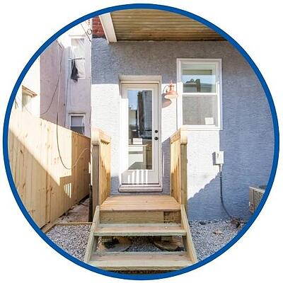 photo of grey exterior addition entryway with brand new unpainted wood steps by Bellweather Design Build in Philadelphia